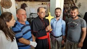 Croix offerte par un ferronnier de Qaraqosh